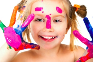 little girl with paint