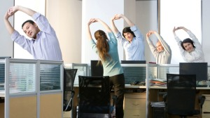 BGBE83 Office workers stretch before they get back to work