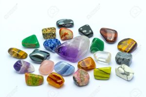 17694394-Colorful-stones-and-minerals-in-white-backgrounds-Stock-Photo