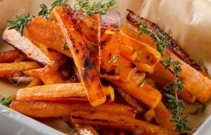 sweet potato fries with fresh thyme . Selective focus
