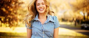happy-woman-with-beautiful-smile-253486-1400x600